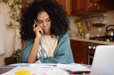 woman having serious phone conversation