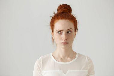 redhead girl looking sideways