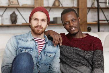 homosexual interracial couple having rest