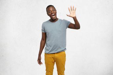 African American man waving his hand