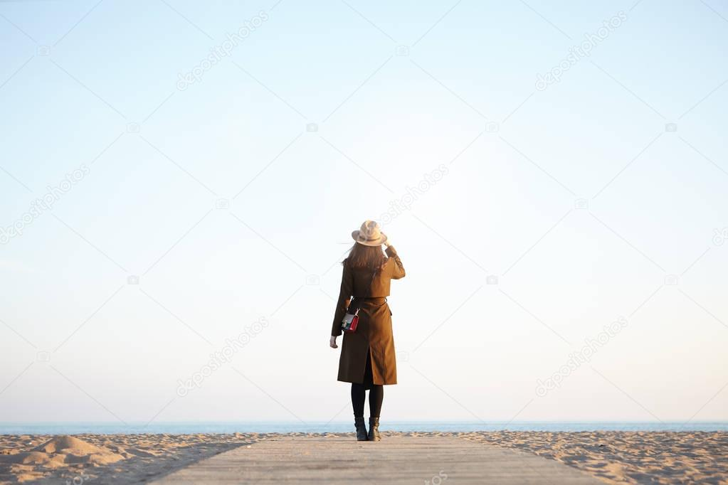 woman traveler enjoying view of calm sea