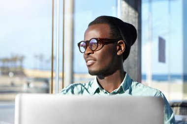 African male in front of laptop