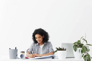 female interior designer drawing