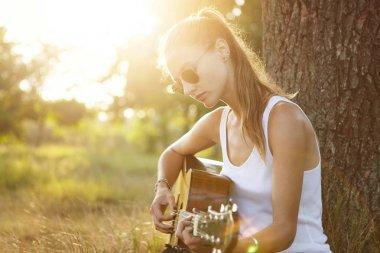 Female playing guitar