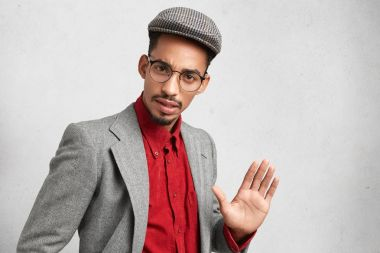 Handsome man wears round spectacles