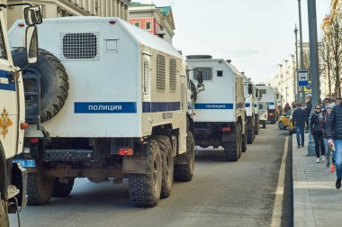 Column of police trucks for arresting people driving along Tverskaya street