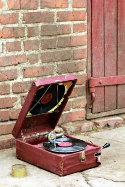 Old vintage gramophone player in a red case