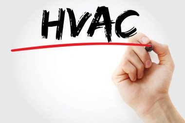 Hand writing HVAC with marker
