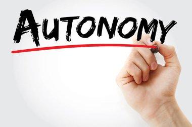 Hand writing Autonomy with marker
