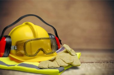 Yellow hard hat and tools