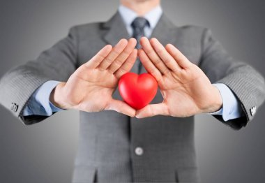Businessman with red heart on left chest