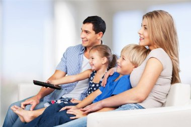 Beautiful Lovely family watching tv