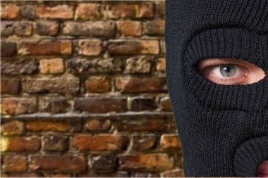 Man in black balaclava