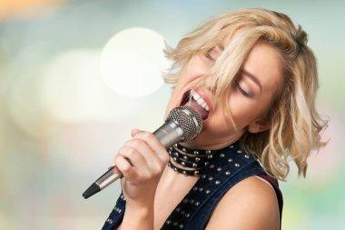 stylish woman singing karaoke