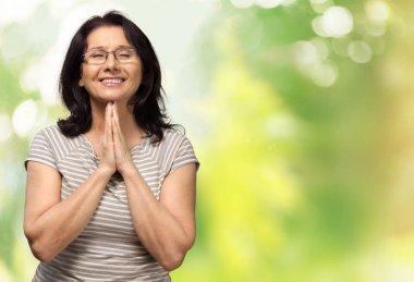 mature woman praying
