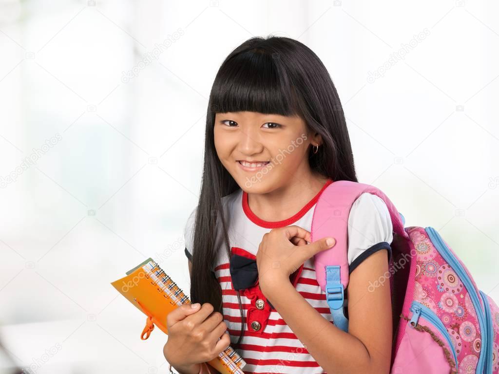 Cute Little Asian Schoolgirl With Book Photo By Billiondigital