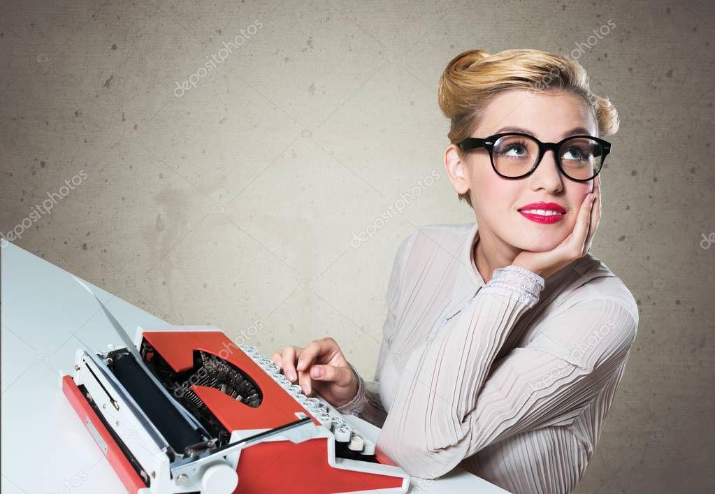Woman working on vintage typewriter