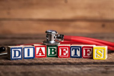 Cubes with word diabetes and stethoscope