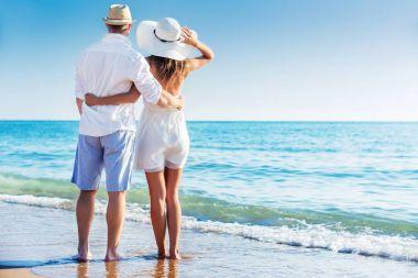 happy Couple walking on beach