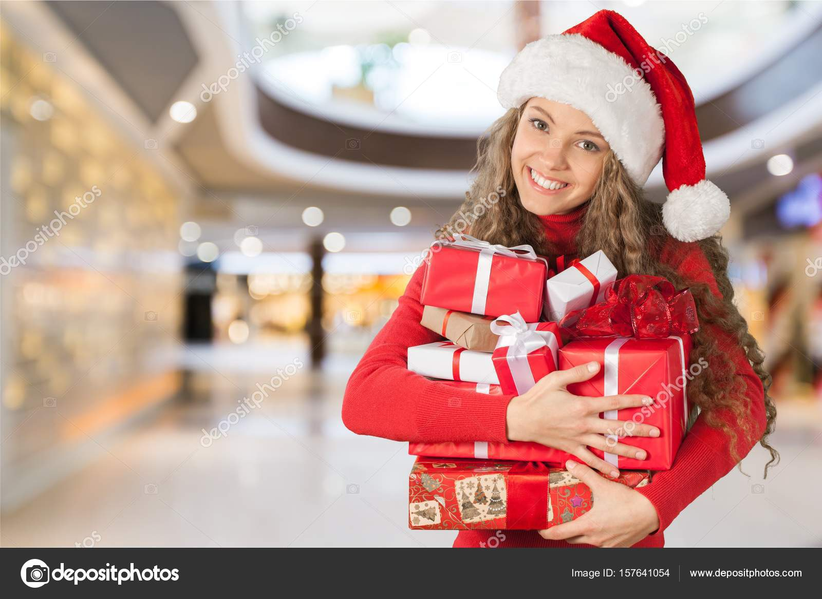young girl with christmas gifts stock photo