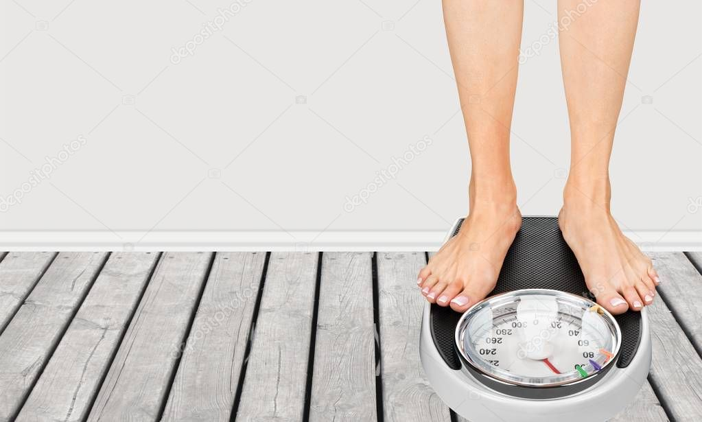 Woman Standing On Weighing Scales Stock Image - Image of