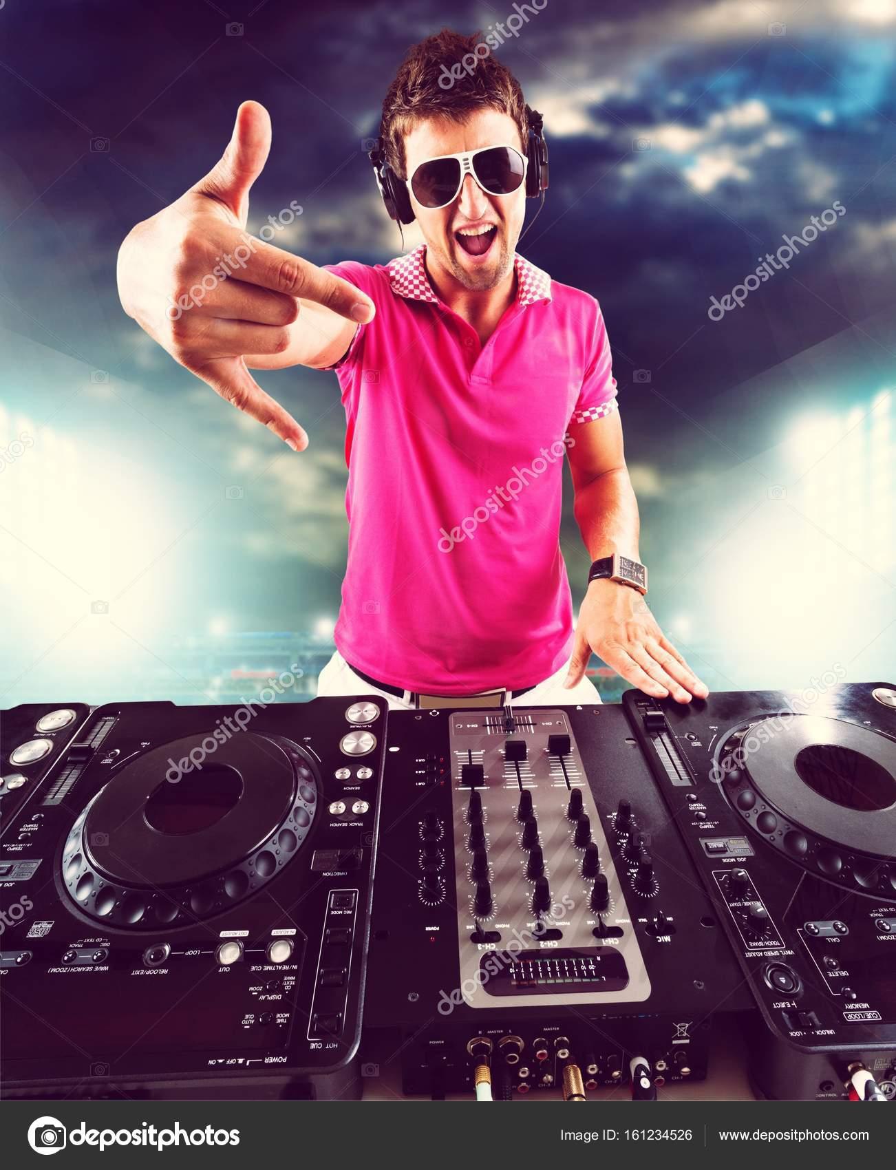 Young DJ with headphones — Stock Photo © billiondigital