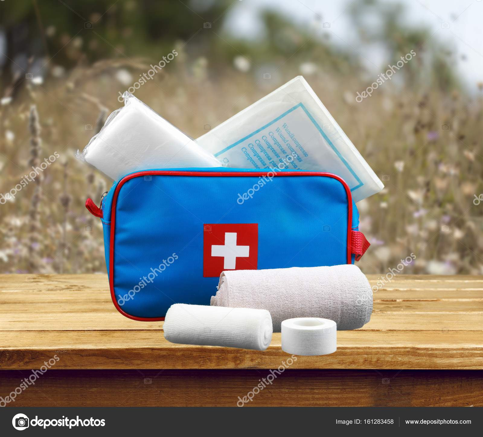 First aid kit with medical supplies — Stock Photo