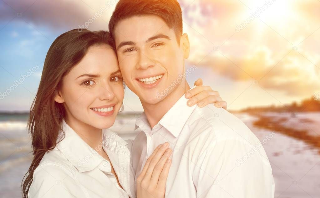 portrait of happy young couple on nature background