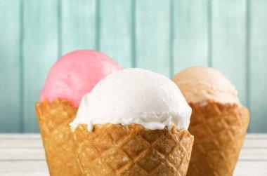 Various ice cream balls on cones