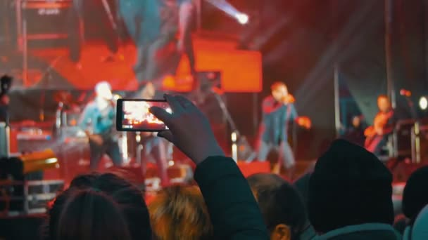 Filming Musicians Performance In The Concert