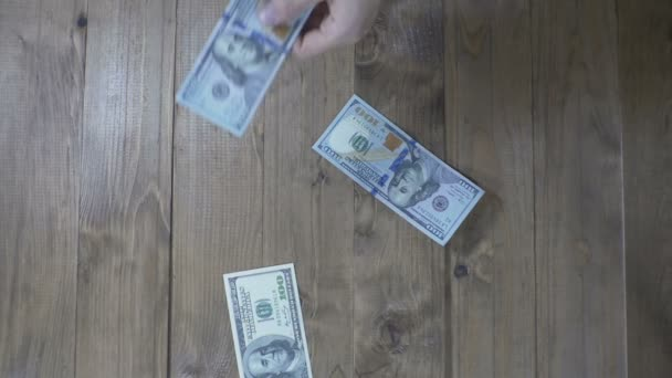 Dollar Banknotes Falling on a Wooden Table. Slow Motion