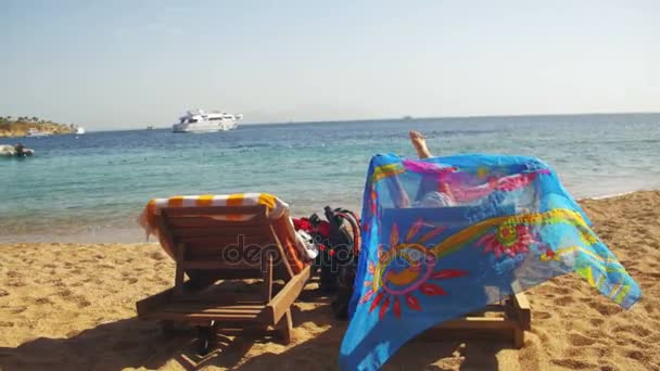 Rest on the Red Sea, the Girl on a Lounger Overlooking the Sea in Egypt
