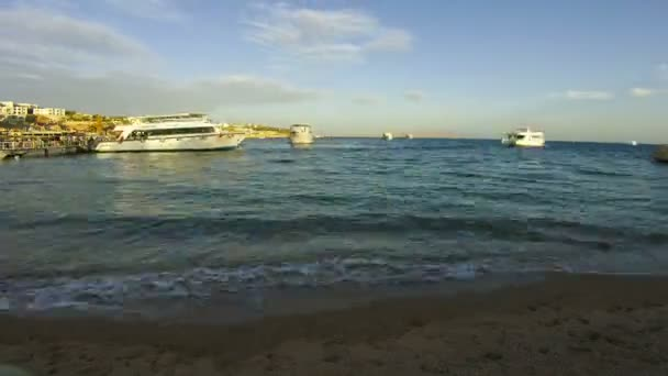 Pleasure Boats Arrive at the Port on the Beach in Egypt. Time Lapse