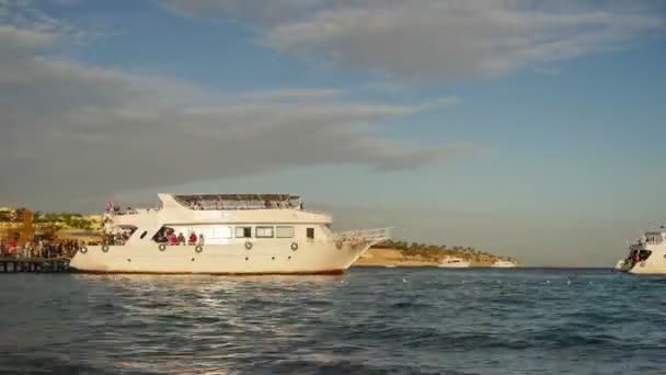 Pleasure Boats Arrive at the Pier on the Beach in Egypt. Time Lapse