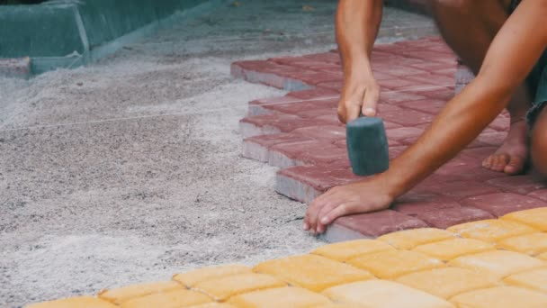 Laying Colored Tiles in a City Park