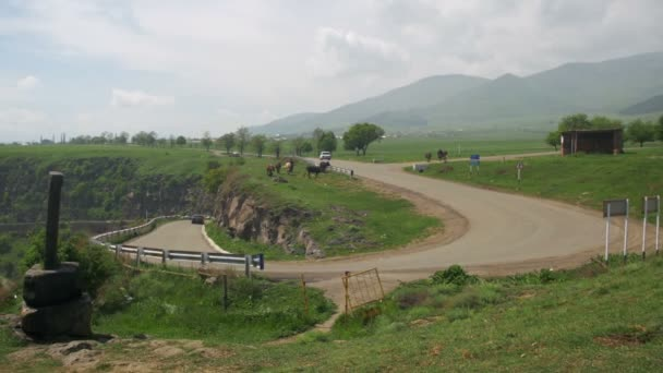 Landscapes of mountains in Armenia. The Mountain Serpentine and Cars.