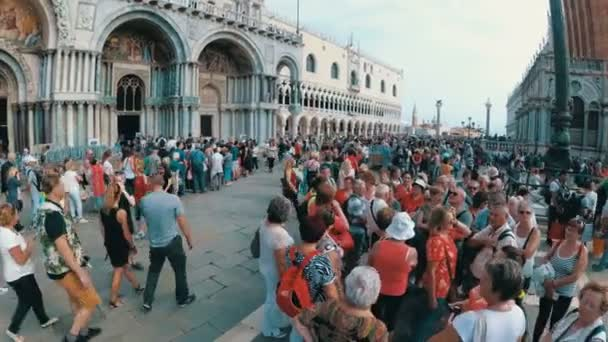 Crowd of people walking on the square of San Marco Venice, Italy