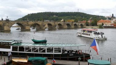 Landscape view of Prague Bridge and Water Bus Boat Floating on the River Vitava