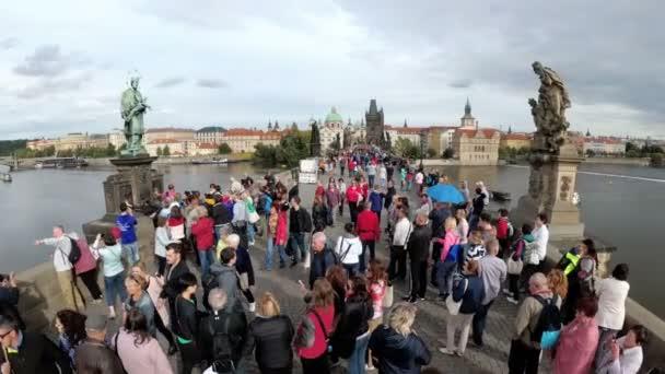 Crowd of people walking along the Charles Bridge, Prague, Czech Republic in Slow Motion