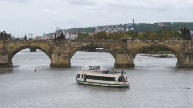 Landscape view of Prague Bridge and Water Bus Boat Floating on the River Vltava