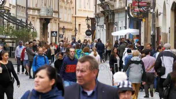 Crowd of People walking along the streets of the old city in Prague, Czech Republic