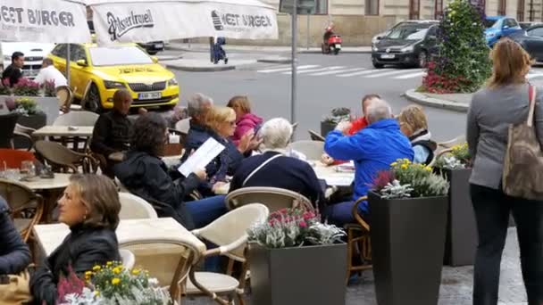 Tourists are Sitting at Tables in Street Cafe on Stare Mesto Square in Old Town, Prague, Czech Republic