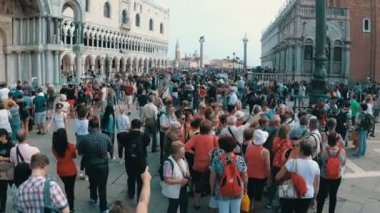 Crowd of people walking on the square of St. Mark, Venice, Italy