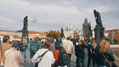 Crowd of people walking along the Charles Bridge, Prague, Czech Republic. Slow Motion