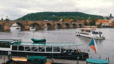 Landscape view of Prague Bridge and Boat Floating on the River Vltava