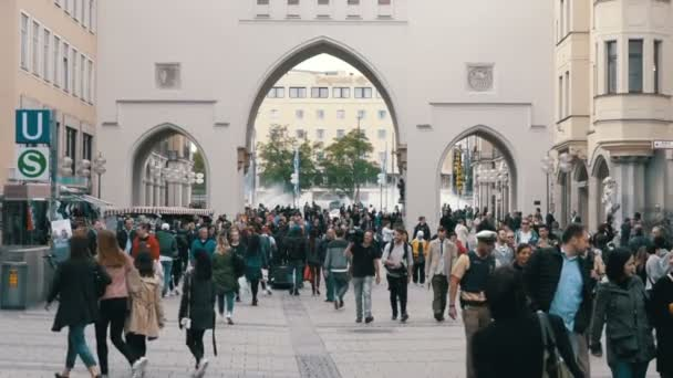 Crowd of people are walking along the Marienplatz Street in Munich, Germany. Slow Motion