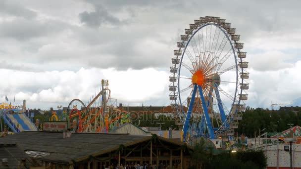 Ferris wheel rotates at the Oktoberfest festival. Bavaria, Germany