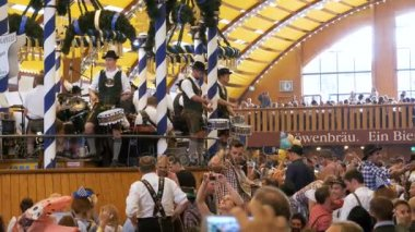 Orchestra band plays inside a large beer tent at the Oktoberfest Festival. Bavaria, Germany