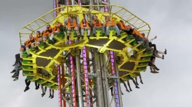 Worlds tallest Attraction mobile drop Sky fall Tower on Oktoberfest. Bavaria. Slow Motion
