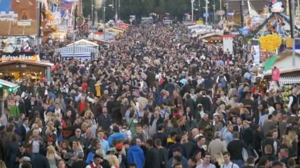 Top view of crowd on central street in Oktoberfest. Bavaria, Germany. Slow Motion